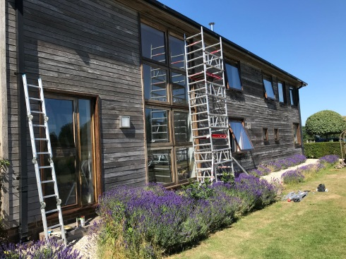 african hardwood windows, frames and doors re-oiled for another season